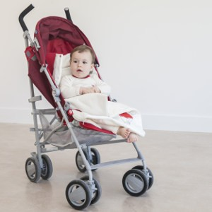 Baby girl with a Zizzz footmuff in a stroller